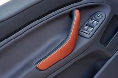 Maniglia sulla porta, pannello di controllo della finestra di automobile Fotografia Stock
