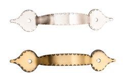 Maniglie del cassetto dell'argento e dell'ottone isolate su bianco Fotografia Stock