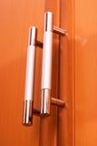 Maniglie della mobilia sui portelli Immagine Stock Libera da Diritti