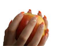 Maniküre auf einem Apfel Stockbilder