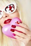 Maniküre und Make-up mit Herzen lizenzfreies stockbild