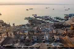 Manikarnika Ghat is one of the ghats in Varanasi India and is most known for being a place of Hindu cremation. Varanasi, India - December, 9th, 2017 Stock Image