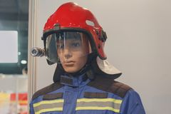 Maniken in the helmet and the form of a rescuer. Industry Stock Photography
