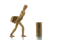 Manikin carrying money Royalty Free Stock Photography
