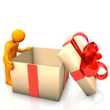 Manikin Empty Gift. Orange cartoon character with big empthy gift box Royalty Free Stock Photography