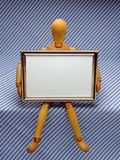 Manikin with Frame /A. An artist's manikin holding a small picture frame that is blank for text or similar Royalty Free Stock Photos
