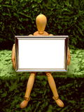 Manikin with Frame /B. An artist's manikin holding a small picture frame that is blank for text or similar Royalty Free Stock Images