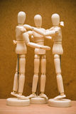 Manikin group hug Stock Image
