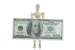 Manikin holds dollar bill Stock Image