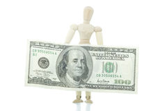 Manikin holds dollar bill Royalty Free Stock Image