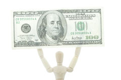 Manikin holds dollar bill high up Royalty Free Stock Images