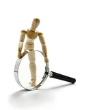 Manikin and magnifier Stock Images
