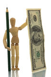 Manikin with pencil and money Royalty Free Stock Image