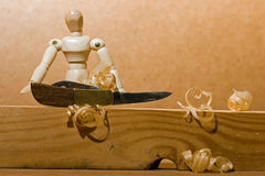 Manikin and penknife. Royalty Free Stock Image