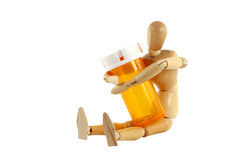 Manikin with pill bottle Royalty Free Stock Photo