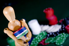 Manikin plays poker Royalty Free Stock Images