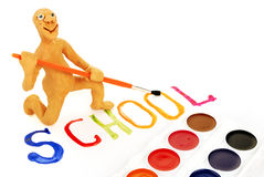Manikin and school word. Plasticine manikin, water-colour paints and  school word Stock Images