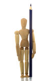 Manikin standing with pencil Royalty Free Stock Images