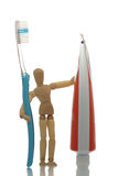 Manikin with toothbrush and toothpaste Stock Photos