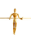 Manikin walking a tightrope Royalty Free Stock Photo