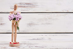 Manikin on wooden background. Invite her for a date Royalty Free Stock Images