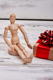 Manikin and wrapped box. Stock Photo