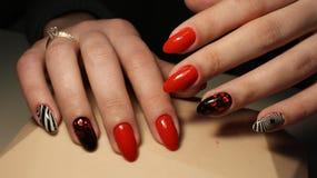 Manikyr spikar röd abstraktion för design Royaltyfria Bilder
