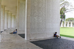 Manila American Cemetery Tablet of the Missing. Two children spending the afternoon amongst the Tablet of the Missing - names of American World War 2 heroes Stock Photo