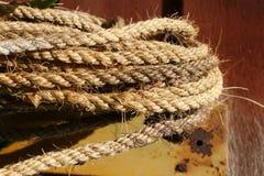 Manila arkana na drewnianej podłoga Obraz Stock