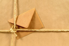 Manila brown envelope, tied package, brown paper background Stock Photo