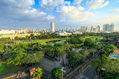 Manila city skyline in Philippines. Ermita and Paco districts seen from Intramuros. Manila, Philippines - Feb 4, 2018 : Manila city skyline in Philippines Royalty Free Stock Image
