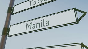 Manila direction sign on road signpost with Asian cities captions. Conceptual 3D rendering Royalty Free Stock Photography