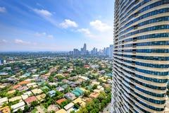 Manila horisont som ses från den Rockwell staden på Augusti 6, 2017 i phien Arkivbild