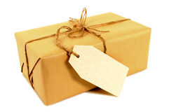 Manila label, brown paper package tied with string, isolated Stock Photography