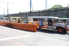 MANILA - MAY 17: colorful jeepneys known for their crowded seati Stock Photos