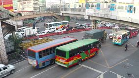 Congested traffic vehicles under railway train. Manila, Philippines - August 7, 2016: Congested busy avenue road under light moving train railway, a perennial stock video