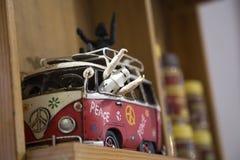 Painted hippie van, toy retro car royalty free stock photos