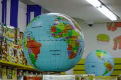 World globe models for sale at bookstore royalty free stock image