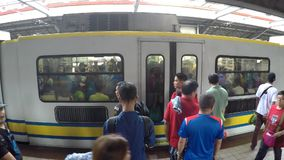 Light Railway Transit LRT passengers wait for the coming train. Manila, Philippines - July 9, 2017: Light Railway Transit LRT passengers waiting for the coming stock footage