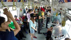 Passengers standing, clogged in light railway transit LRT. Manila, Philippines - July 9, 2017: Train Passengers standing, congested  in light railway transit LRT stock video footage