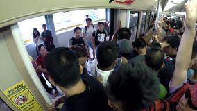 Passengers standing, clogged in light railway transit LRT. Manila, Philippines - July 9, 2017: Train Passengers standing, congested  in light railway transit LRT stock video