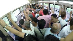 Passengers standing, clogged in light railway transit LRT. Manila, Philippines - July 9, 2017: Train Passengers standing, congested  in light railway transit LRT stock footage