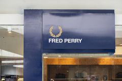 Manila, Philippines, 22 March 2018 - Fred Perry brand name on storefront in SM Mall of Asia shopping mall. Fashion store label. Casual wear shop front. Famous Stock Images