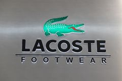 Manila, Philippines, 22 March 2018: Lacoste brand name on storefront in SM Mall of Asia shopping mall. Urban fashion wear logo with green crocodile. Casual Royalty Free Stock Photos