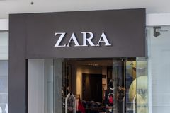 Manila, the Philippines - 22 March 2018: Zara brand name on store entrance in SM Mall of Asia shopping mall. Fashion store label. Casual wear shop. Famous Royalty Free Stock Images