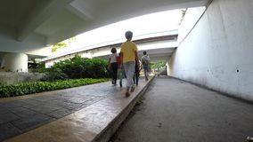 Urban fast life people walk in underpass. Manila, Philippines - November 13, 2016: urban fast life people pedestrians walk in underpass stock video footage