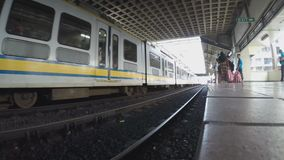 Arriving light railway transit at station. Manila, Philippines - October 26, 2015: Arriving Light Rail Transit Train in passenger station, a build-operate stock footage