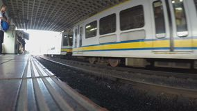Departing light railway transit train from station. Manila, Philippines - October 26, 2015: Departing Light Rail Transit Train from passenger station, a build stock video footage