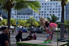 Zumba Dancing instructor leading mature women in morning exercise at bay park stock image