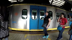 Departing Light Rail Transit Train from passenger station,. Manila, Philippines - September 25, 2016: Departing Light Rail Transit Train from passenger station stock video footage